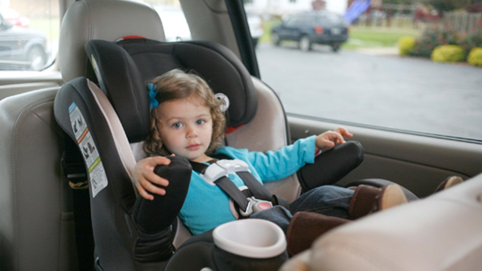 A toddler girl sitting in a car seat