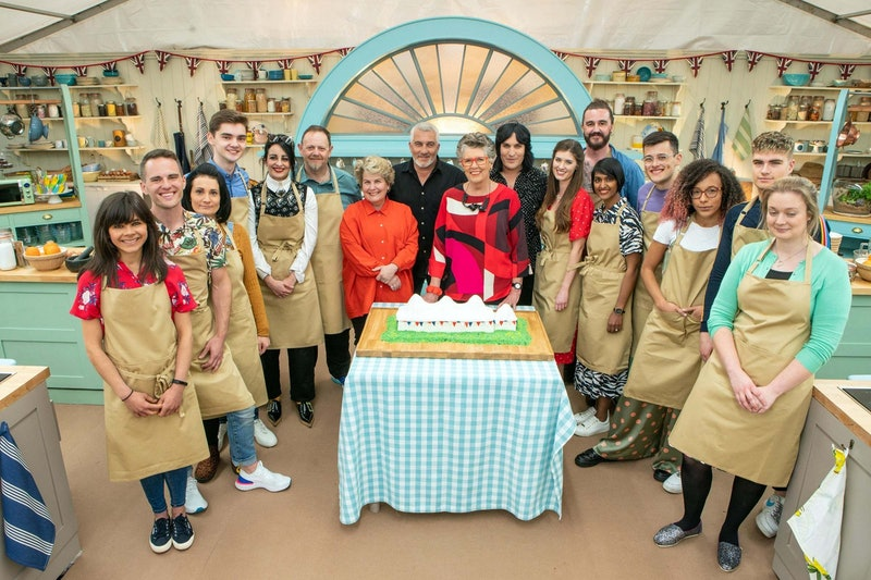 The cast of 'The Great British Bake Off's 10th season poses together in the tent.