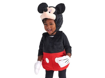 A toddler in a mickey mouse costume