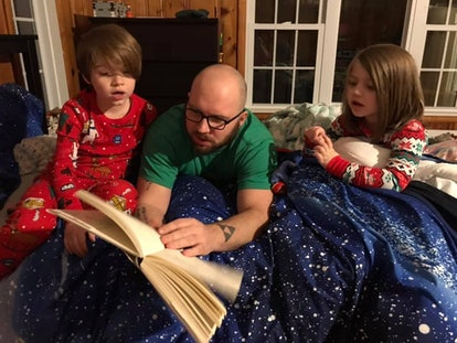 The writer's husband pictures reading a bedtime story to their two children, ages 8 and 4.