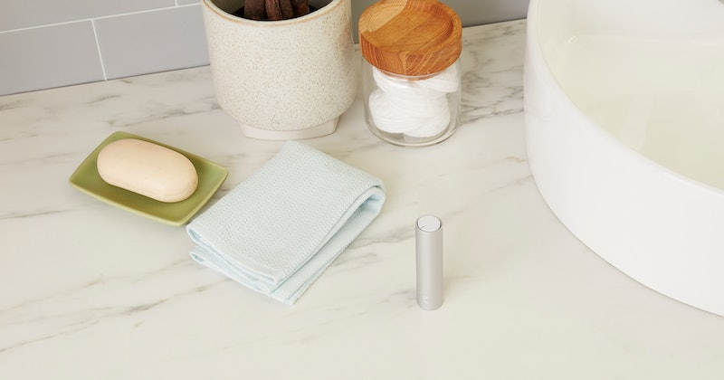 quip's new Refillable Floss on bathroom counter beside sink