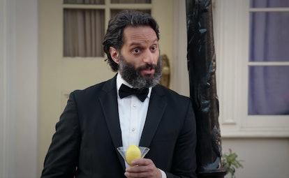 Jason Mantzoukas as Derek holding a lemon martini in 'The Good Place'