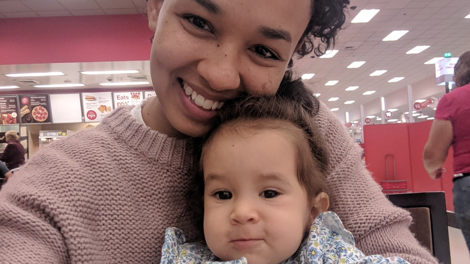 Mom and toddler cuddle in Target