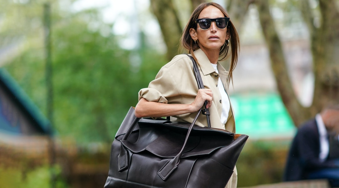 Street style photo of influencer carrying an oversized Bottega Veneta bag at London Fashion Week Spring 2020.