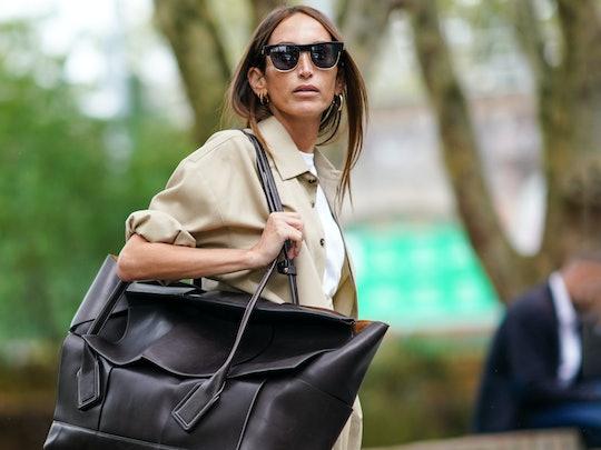 Street style photo of influencer carrying an oversized Bottega Veneta bag at London Fashion Week Spring 2020.