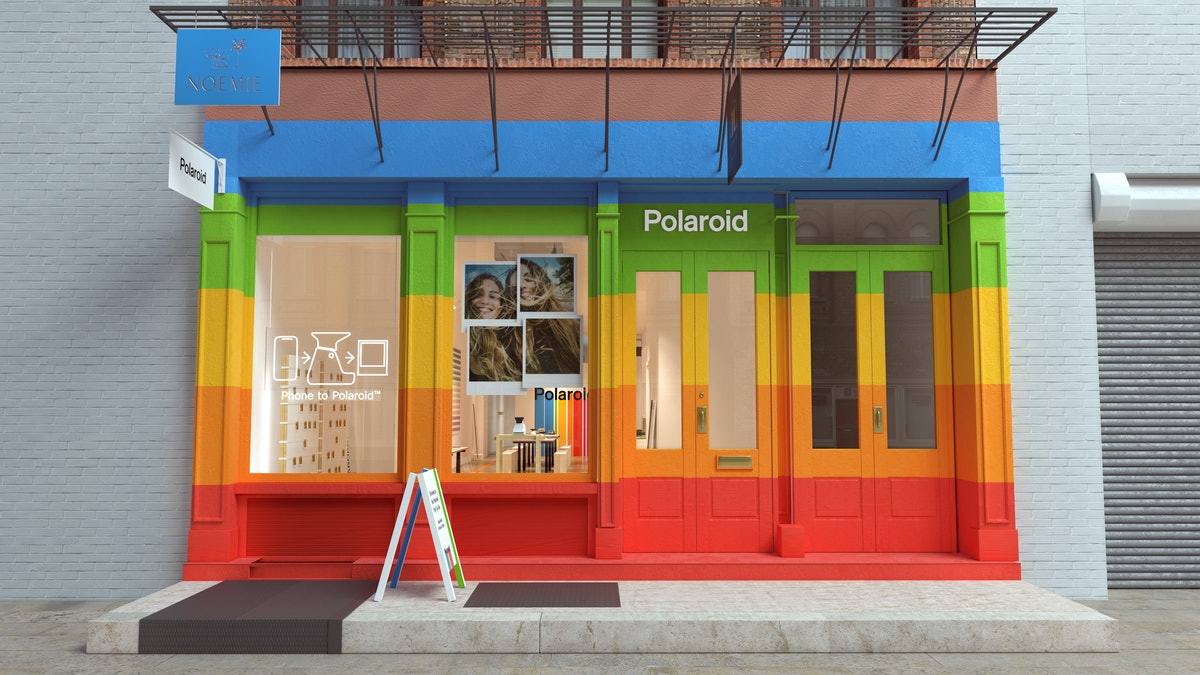 The front of the Polaroid Pop-Up Lab in NYC is rainbow-colored.