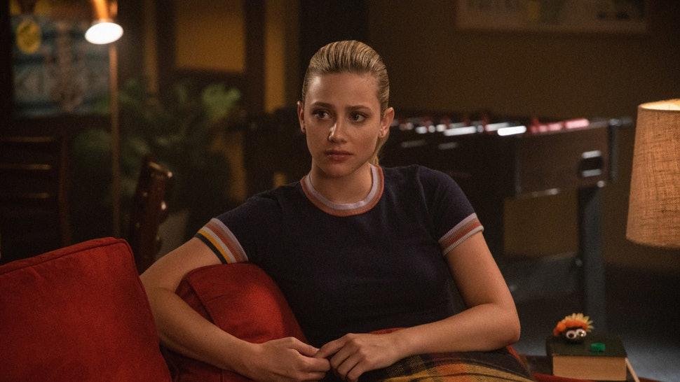 Betty sitting on a couch on Riverdale