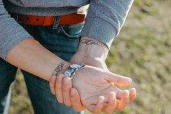 couple with simple matching tattoos inside the wrist