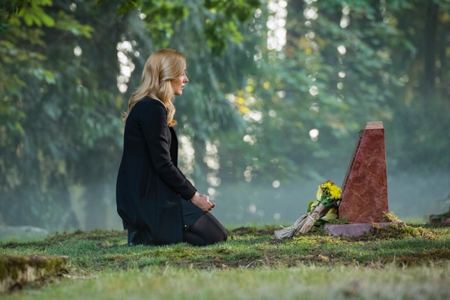 Nancy sitting at her mother's grave on Nancy Drew