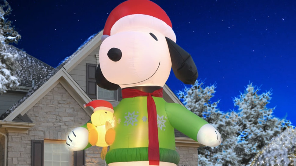 Hammacher Schlemmer is selling huge inflatable Snoopy lawn decorations.