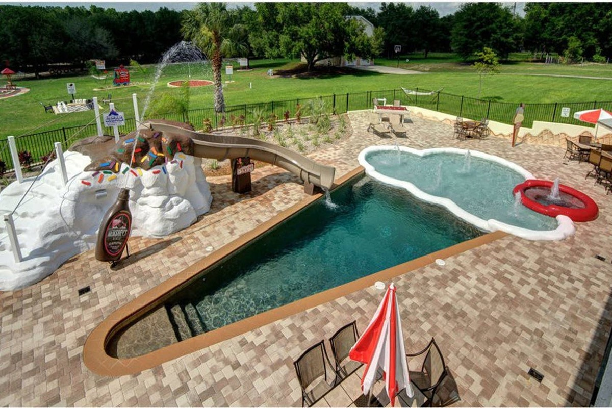 """An ice cream-shaped pool and sundae waterslide are featured at """"The Sweet Escape"""" Airbnb."""
