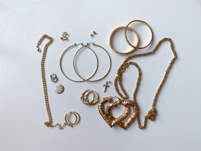 Photo of gold jewelry styles often worn by Latinx people.