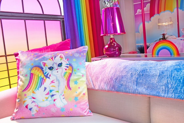 Hotels.com Lisa Frank Flat couch with kitten pillow.