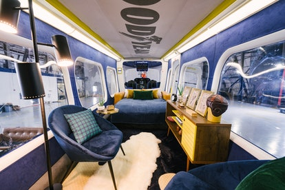 Comfortable bed in the Goodyear Blimp Airbnb listing.