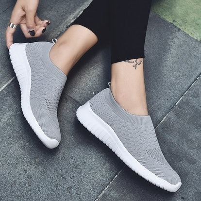 These popular slip-on shoes are made with a knit fabric that hugs your feet for a comfortable, snug ...