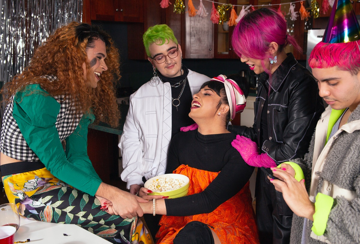 A group of LGBTQ people not assuming each other's gender and sexual identity.