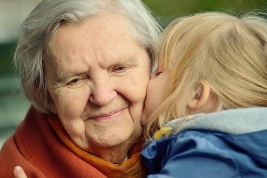 grandchild kisses her grandmother