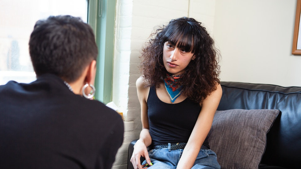 A transgender woman sitting on a therapist's couch and listening. The majority of Americans knows that there is a lot of stigma against talking about mental illness, according to a CBS News poll.