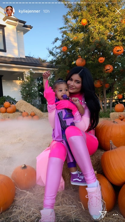 Kylie Jenner and Stormi dressed as matching superheros for Halloween.