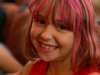 Girl smiles at camera