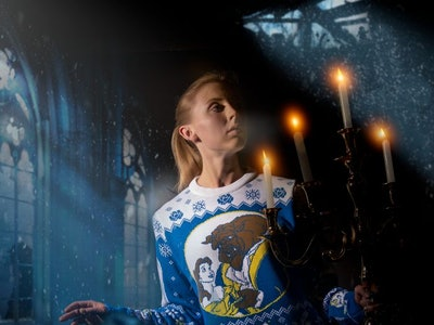 woman in a Disney ugly Christmas sweater