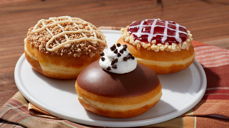 Krispy Kreme's Pie-inspired holiday doughnuts for Thanksgiving are filled with all your favorite fillings from cherry pie to chocolate