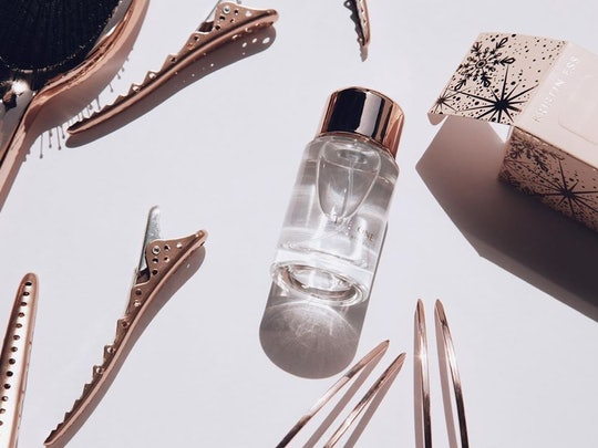 Perfume, brush, and clips from Kristin Ess' holiday sets
