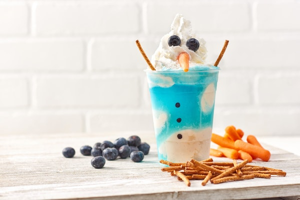 The Melting Snowman shake has pretzel arms and blueberry eyes and is available at the Vivoli il Gelato in Disney Springs this holiday season.