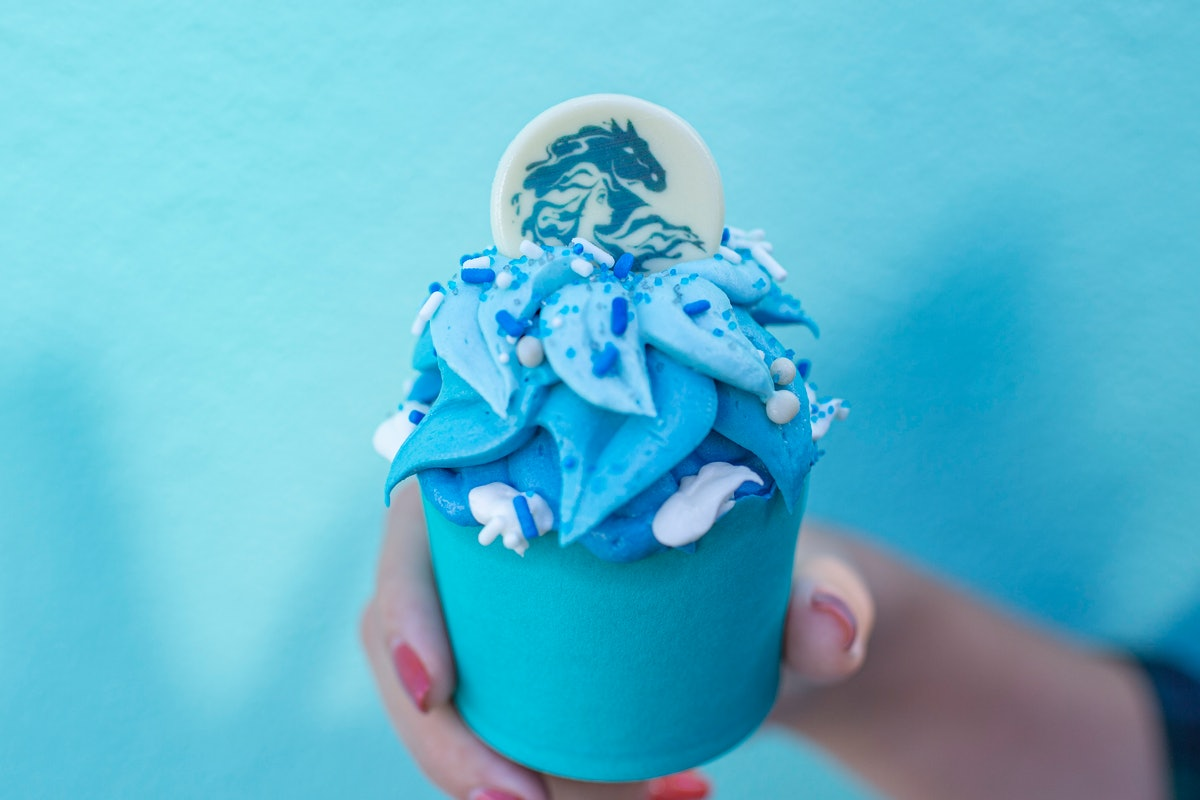 The Frozen Fractals Cupcake with white and blue frosting is available at Disney in celebration of 'F...