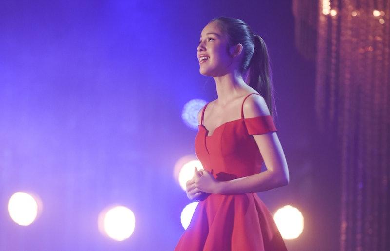 Nini singing as Gabriella Montez in High School Musical: The Musical: The Series