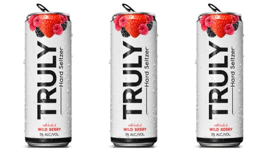 Row of Truly Spiked seltzer in Wild Berry