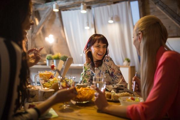 Female friends celebrating Friendsgiving