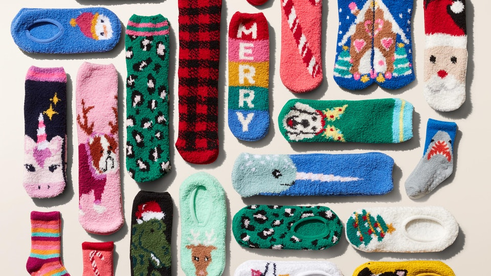 An assortment of Old Navy's fuzzy holiday-themed cozy socks on sale for $1 each.