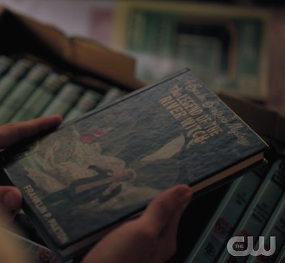 Jughead holding a Baxter Brothers book on Riverdale