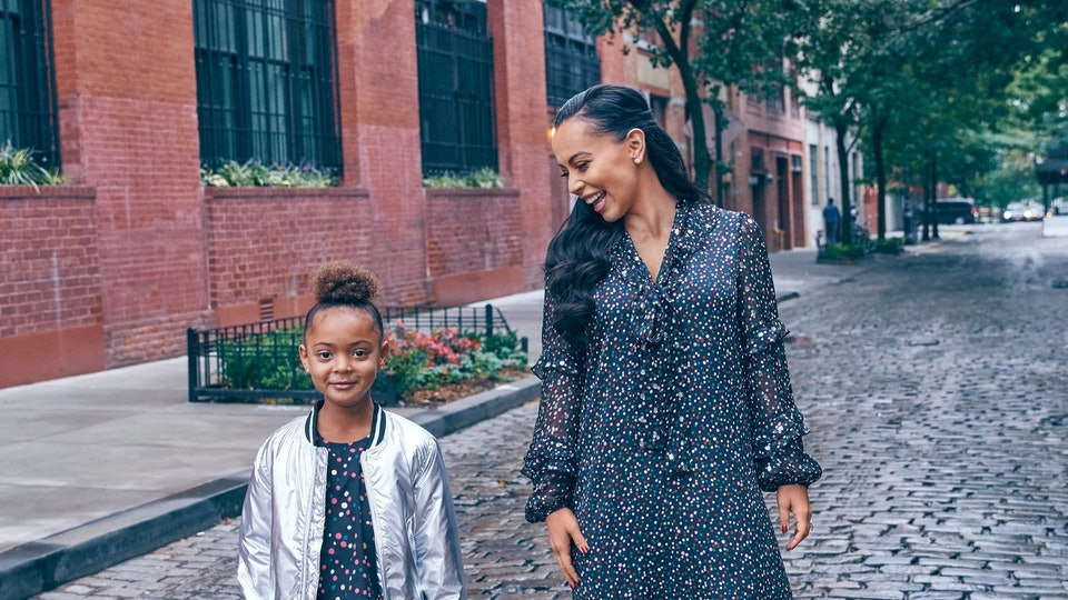 A mom and her daughter on a city street wearing Diane von Furstenberg X Rockets of Awesome