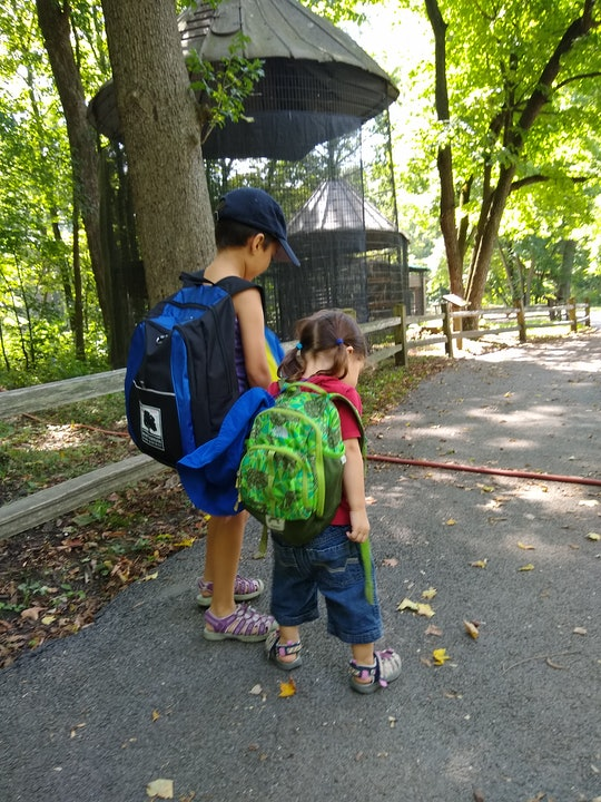 Rae's two children, on a typical day of homeschooling, visiting the local nature center