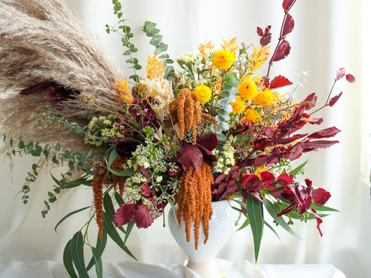 Dried flowers make floral arrangements for fall dinner parties much more versatile