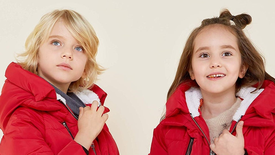 a boy and a girl wearing red orolay hooded down jackets