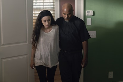 Christian Serratos as Rosita Espinosa and Seth Gilliam as Father Gabriel Stokes in The Walking Dead Season 10