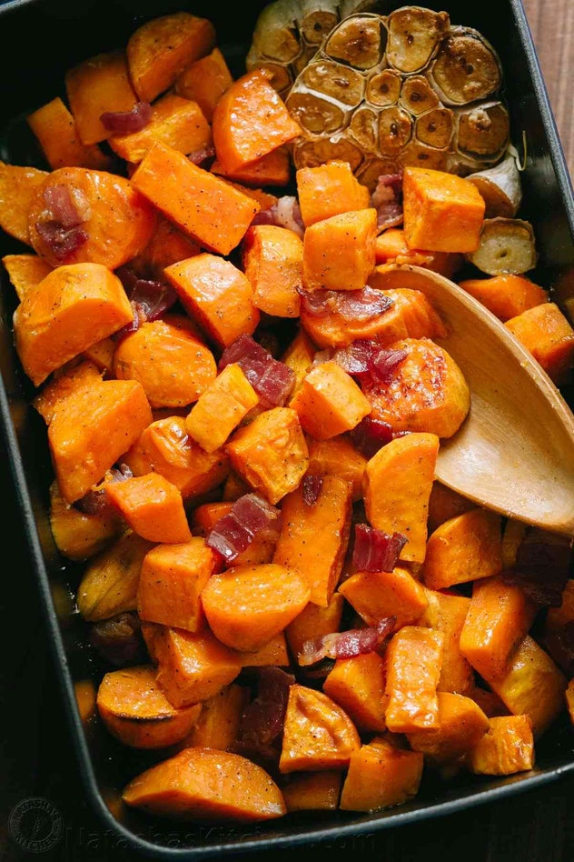 Easy Thanksgiving dishes; pan of maple roasted sweet potatoes with bacon
