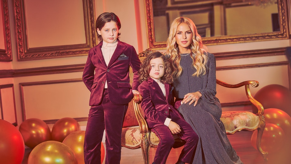 Portrait of Rachel Zoe with her two sons wearing pieces from the Rachel Zoe x Janie and Jack party collection