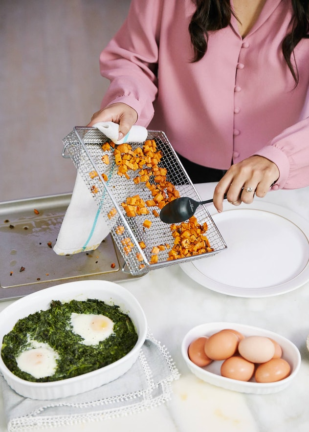 Easy Thanksgiving Dishes; Air Fryer Sweet Potatoes being scooped on to a platter