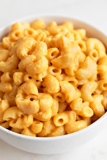 A close-up image of a white bowl full of vegan mac and cheese. You don't need cheese to make an exce...