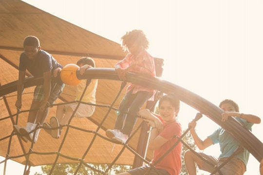 children climbing on a playground after school