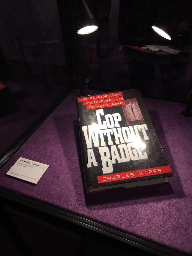 'Cop Without a Badge' book in display case at BravoCon 2019