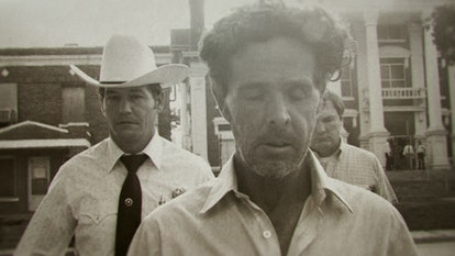 Henry Lee Lucas walking in front of Ranger Phil Ryan.