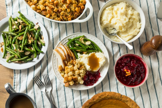 easy thanksgiving recipes; thanksgiving spread featuring cranberry sauce, mashed potatoes, and more