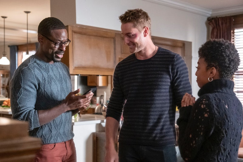 Randall and Kevin smiling while talking to Tess on This Is Us