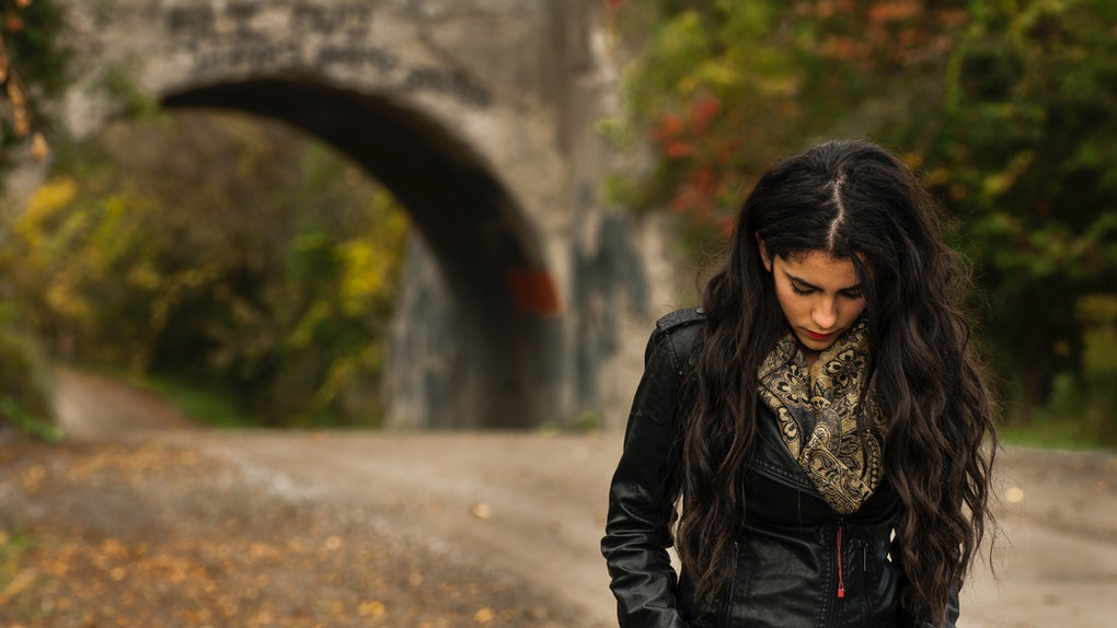 Girl walking in the fall, having a bad November day.