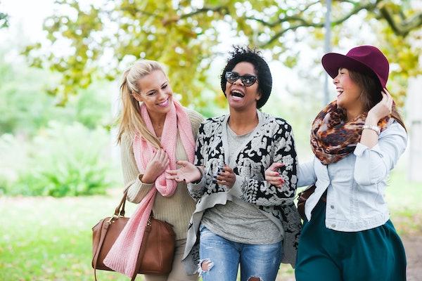 Women friends having best November fall day.